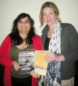 Dr. Monika Spolia presenting her books to Melanie Joly