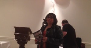 Monika Spolia reciting poetry at the synagogue in Cote-des-neiges, Montreal