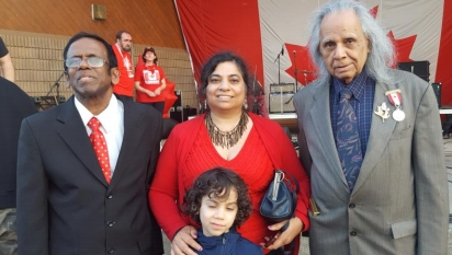 Pastor Peter Rajan, Dr. Monika Spolia and her son SarvNathan with Stephen Gill honored at Canada's 150th Anniversary