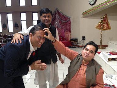 Pulkit Kantawala, city councilor for DDO District 7, getting blessed by Pandit Dharampal ji as Pandir Vimlesh ji puts Tilak on his forhead at Hindu Mandir DDO on Nov 12, 2017
