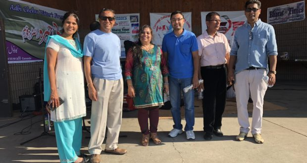 Celebrating Cornwall Cultural Festival 2018 Mela at Lamoureux Park, Cornwall on August 12, 2018 - (Geeta Kantawala, Mr. Pulkit Kantawala (city councilor for Dollard-des-Ormeaux District 7), Dr. Monika Spolia (organizer of the Festival and Editor and Publisher of Bharat Times Newspaper in print and online), a guest, Mohammad Naeem Talat and Shoaib Sadiq of S&S Advertiser (main sponsor of the Mela) and Adbi Chehra Writer's Forum — in Cornwall, Ontario